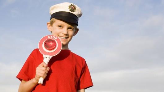 Boy (10-13) wearing police cap